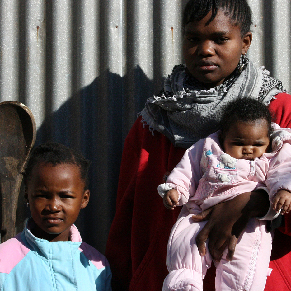 young black  woman with two little kids in the township kagiso