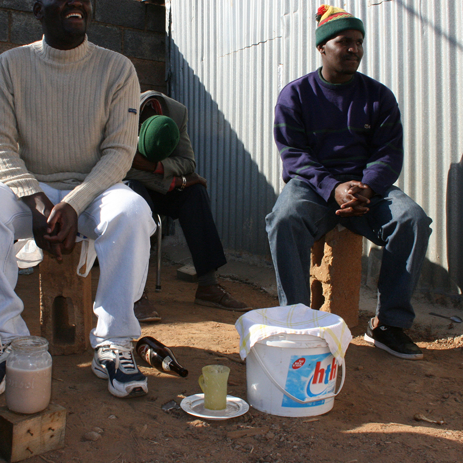 men drinking self brewed beer south africa in the township kagiso