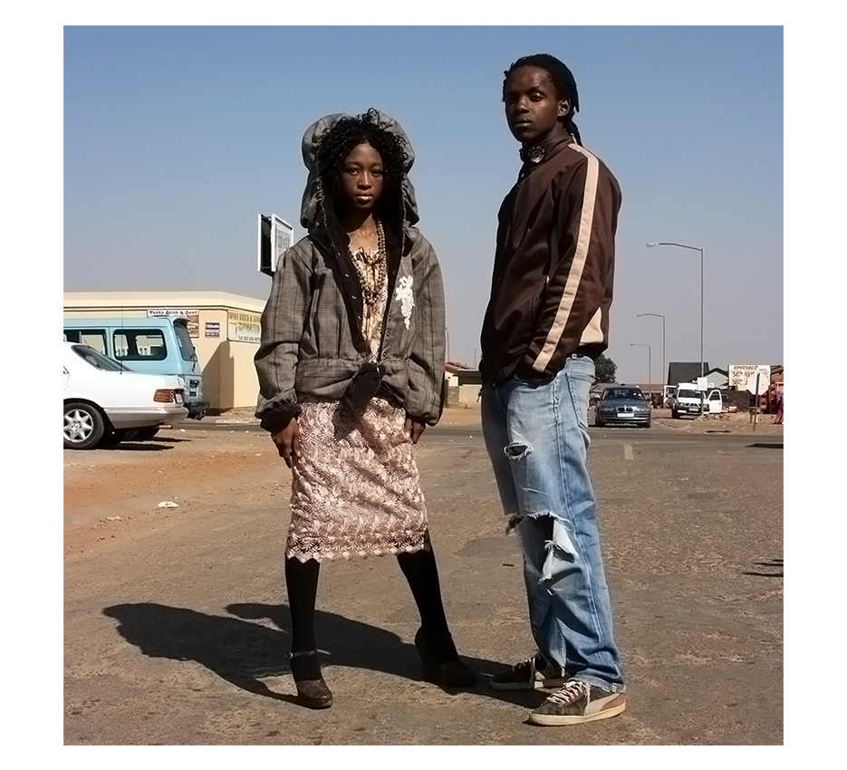 two Kagiso black Hipsters posing in the middle of the street for the camera